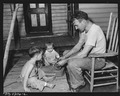 D.B. Henry, miner, who has worked for the company four years, repairs his children's wagon. He has made many minor... - NARA - 540735.tif