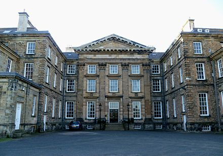 The south front of Dalkeith Palace in 2011, showing pilasters and pediment. Dalkeith Palace in 2011.jpg