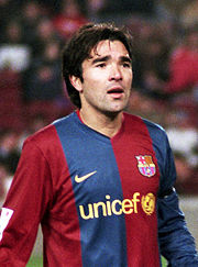 Deco wearing the shirt with the Unicef logo.