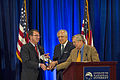Defense Secretary Ash Carter accepts the Center for the National Interest's 2015 Distinguished Service Award from Zalmay Khalilzad, a member of the center's board of directors, and Graham Allison, a member of i 150609-D-DT527-0192A.jpg