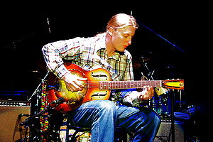 Derek Trucks - Trucks playing a resonator guitar