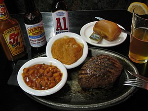 Cowboy beans - Cowboy beans (bottom-left) accompanying a steak dinner
