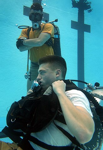 Scuba skills - The instructor monitors a trainee practicing diving skills