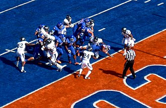 Martin (center) dives for a touchdown while playing for Boise State. Doug Martin TD vs Nevada 10 1 11.JPG