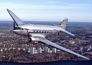 Douglas DC-3 - A DC-3 operated in period Scandinavian Airlines colors by Flygande Veteraner flying over Lidingö, Sweden (1989)