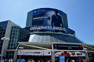 Electronic Entertainment Expo 2015 - The Los Angeles Convention Center during E3 2015, with Uncharted 4: A Thief's End and Street Fighter V occupying entrance advertising.