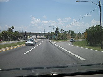 Florida State Road 50 - Eastbound SR 50 at the interchange with US 27 in Clermont, in July 2011. The interchange was rebuilt by FDOT between 2012 and 2014.