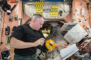 Barry E. Wilmore - Wilmore reads an instruction manual for using an IMAX camera inside Node 1 of the ISS.