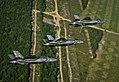 F-35 Lightning II variants in flight near Eglin AFB 2014.JPG