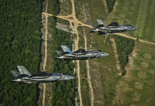 F-35 Lightning II variants in flight near Eglin AFB 2014