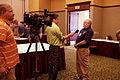 FEMA - 41319 - FEMA Region 5 Flood Insurance Liaison officer talking to a reporter in MN.jpg