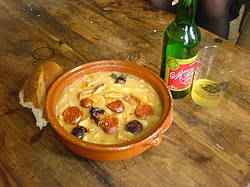 Fabada Asturiana, typically served with crusty bread and Asturian cider