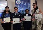 Family, friends gather to celebrate during naturalization ceremony 150320-F-YG475-377.jpg