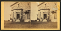 Family posing in front and in the balcony of stone house, from Robert N. Dennis collection of stereoscopic views 9.png