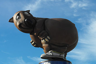 "Wombat - Side view of ""Fatso the Fat-Arsed Wombat"", an unofficial mascot for the 2000 Summer Olympics as he appeared on top of a pole outside Sydney's Stadium Australia"