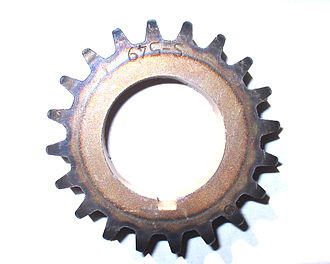 Differential heat treatment - A flame-hardened timing-sprocket. The discoloration around the teeth indicate the metal that was heated and quenched, with the heat-affected zone visible as a thin layer between it and the ring of tempering colors.