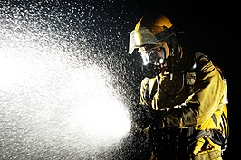 Flickr - Official U.S. Navy Imagery - Damage Controlman 1st Class Hector Floresdiaz demonstrates firefighting techniques..jpg