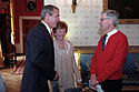 Fred Rogers greeted by President Bush in the White House