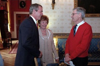President George W. Bush greets Fred Rogers of...