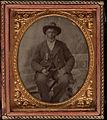 Full length portrait, man seated in Union uniform. Cased tintype, sixth plate.jpg