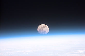 This view from orbit shows the full moon partially obscured by Earth's atmosphere. Full moon partially obscured by atmosphere.jpg