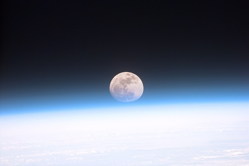 Full moon partially obscured by atmosphere