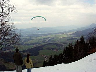 Gaisberg - Paraglider flying eastwards from the top of the Gaisberg.