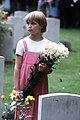 Girl with flowers at war graves.jpg
