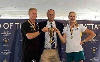 Head of the Schuylkill Regatta - 2014 Winners Kjetil Borch and Kim Crow being presented with the Gold Cup by Sir Steve Redgrave