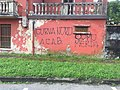 Graffito contro Como e polizia ultras del Varese stadio Ossola.jpg