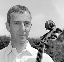portrait of Graham Waterhouse, holding a cello