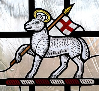 Paschal mystery - Paschal Lamb with the banner symbolising Christ's resurrection. Stained Glass, Anglican cathedral at Guildford, Surrey, England.