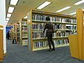 HKCL Central Library interior bookcase visitors.JPG