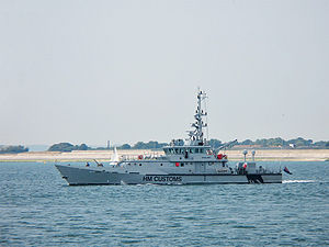Illegal immigration - HMC Vigilant, one of several customs cutters of the UKBA, capable of speeds up to 26 knots departing Portsmouth Naval Base.