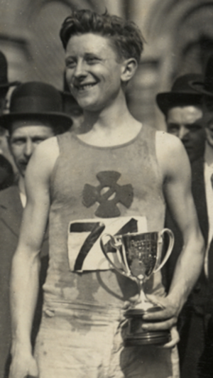 Harry Smith (athlete) - Smith in 1911, holding a trophy.