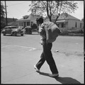 Hayward, California. Youth on Relief. High School student calling for surplus commodities for his family on relief.... - NARA - 532125.tif
