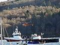 Helicopter filling water bucket in Tobermory Bay (46047210791).jpg