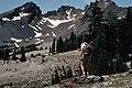 Hiker takes in view of Broken Top, Deschutes National Forest (35944607090).jpg