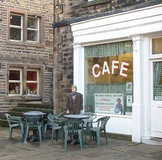 Last of the Summer Wine - Sid's Café in Holmfirth, a regular filming location. The café has become a tourist destination on the strength of the series, and features a model of Compo outside for photographic purposes.