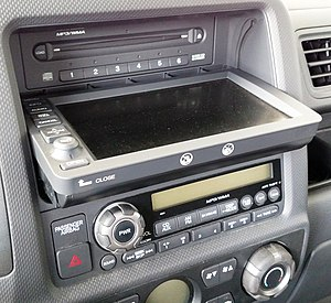 Honda Ridgeline - Ridgeline's equipped with navigation have a six-disc CD player behind the touchscreen which pivots down for access.