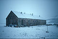 Horseshoe Island hut in snowstorm.jpg