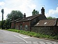 House at the junction near fishing lake, Litcham - geograph.org.uk - 522980.jpg