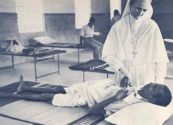 Salesian sister caring for sick and poor in former Madras Presidency. Catholic women have been heavily involved as care givers Hunger and sickness Madras.jpg