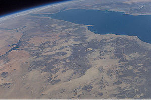 Arabian-Nubian Shield - Astronaut photograph (ISS006-E-43186) of the Arabian-Nubian Shield in eastern Sudan, looking NE, with the Red Sea in the background. The N-S structure in the center of the image is the Hamisana Shear Zone. The ANS exposures in eastern Egypt to the north can also be seen, as well as part of the Nile (left) and Arabia (right).