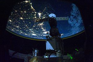 English: Night time astronaut image of the nor...