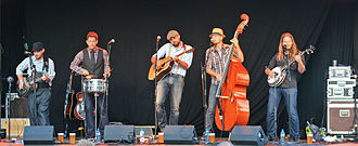 Double bass - Double bass is the standard bass instrument in bluegrass. The Norwegian band Ila Auto, shown here, shows that the bass can be a head taller than the bassist (Kristoffer Iversen).