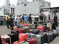 Indian evacuees from Yemen lining up for embarking INS Sumitra during Operation Raahat (1).jpg