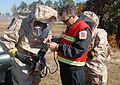 Inspection officer helps HAZMAT technician DVIDS349205.jpg