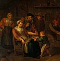 Interior of a surgery with a woman having blood let from the Wellcome V0017551.jpg