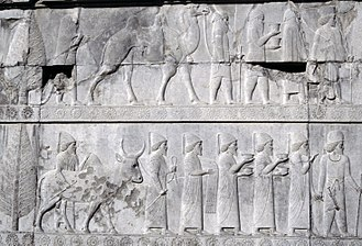 Achaemenid Empire - Reliefs of gift-bearing delegations in Apadana staircase of Persepolis; the ones depicted here are Arian(?) (upper) and Babylonian (lower) delegations.
